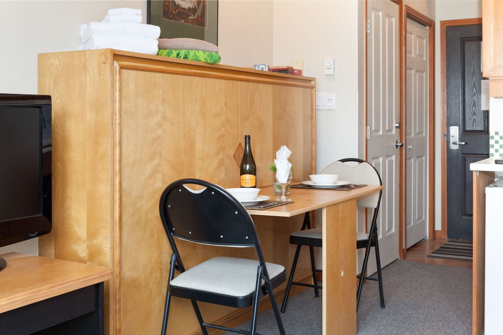 Dining table for two, closets for your clothes, hangers, iron and ironing board....