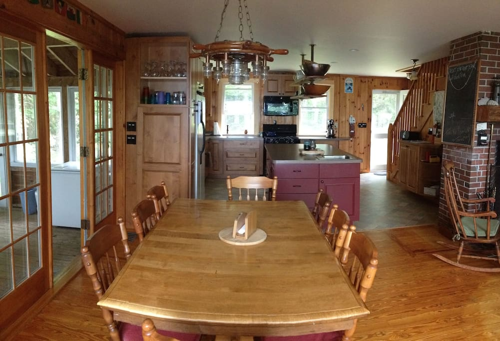Large dining room table opens up to kitchen