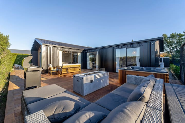 The oversized deck including a BBQ, fire table, lounge suite, dining suite and spa.