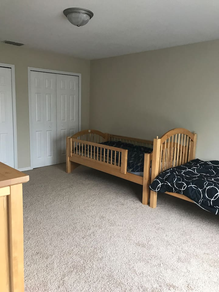 Room is a work in process, but there are double closets and two twin beds currently. Can rearrange setup if need be for longer term stays. Ask if you have questions.