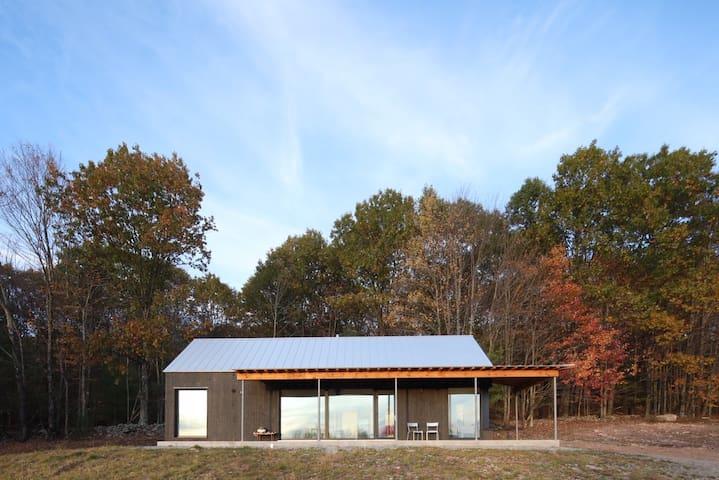 Stunning Passive Solar Cabin on 135 acres