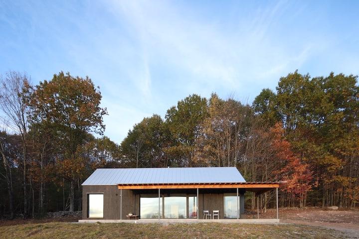 Stunning Passive Solar Cabin on 135 acres & pond