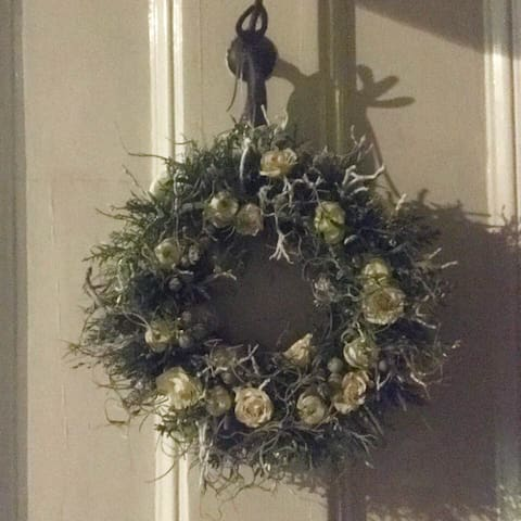 Front door with a beautiful wreath