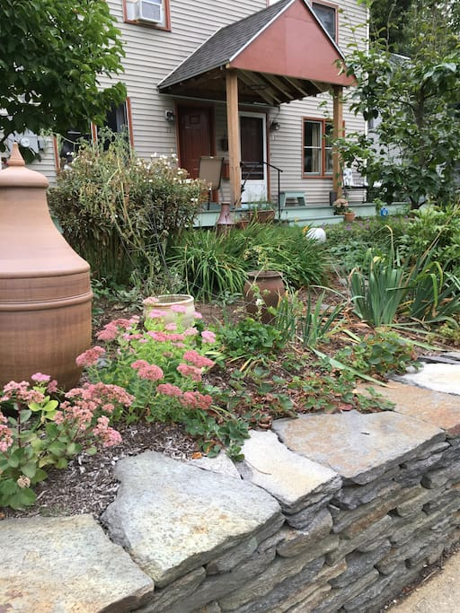 Gardens, giant ceramic vessels made by Steve, artisan-made Adirondack-style chairs on the unfinished porch, neighbors walking their dogs, children running through the yard, woods in the back -- these are a few of the things we love about living here.