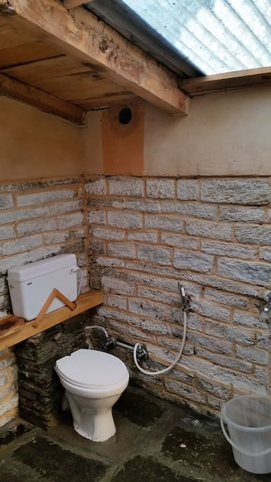 Earthy western toilet with a skylight roof. A luxury in these places!