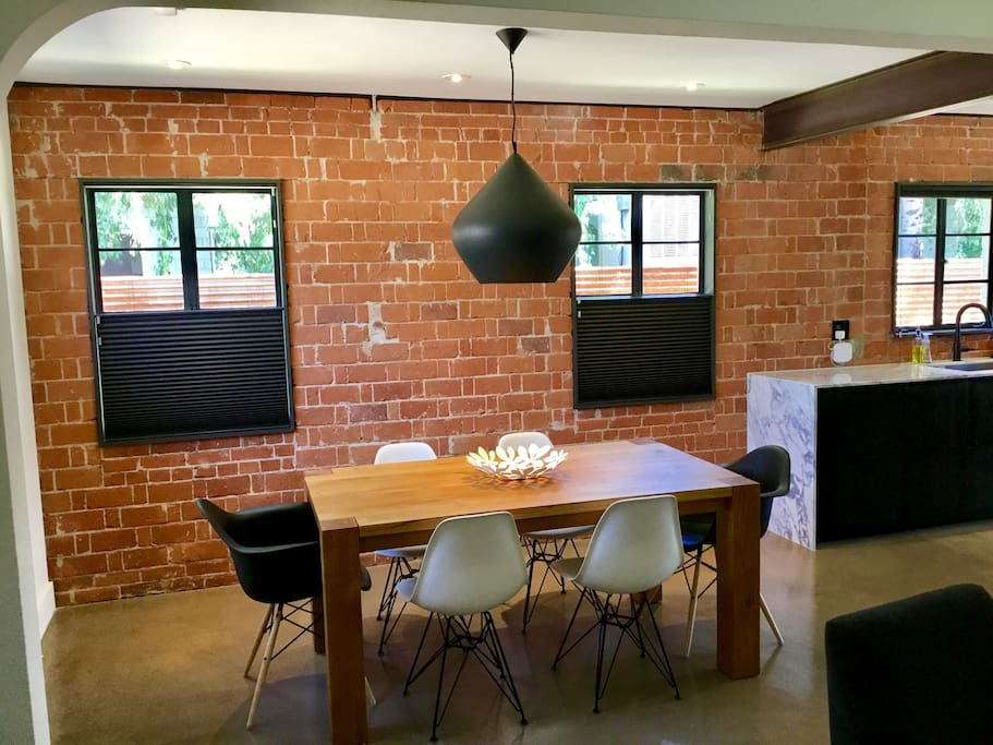Dining room and kitchen with original brick