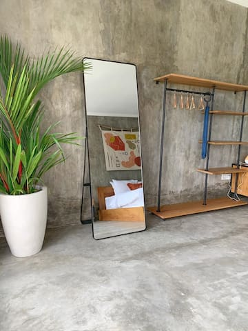 Bedroom full length mirror, umbrella, clothes hanger & storage arrangement.