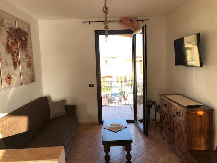 Affascinante Appartamento ''Casa Vacanza tra Alghero e Stintino'' con Aria Condizionata, Wi-Fi, Balcone, Terrazze e Vista Mare; Parcheggio disponibile