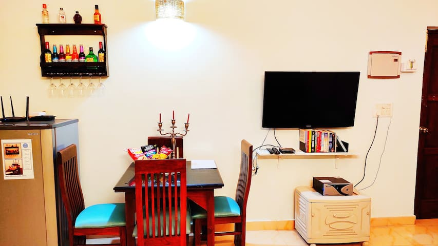 A mini bar along with small eat, and a small luxurious granite dinning table. Along with small uoadted library for the readers . There is full power back up , to give you comfort at all times