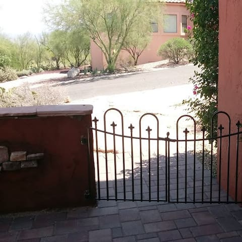Patio greeting gate with off street private parking on  circle driveway and is convenient for easy luggage towing.