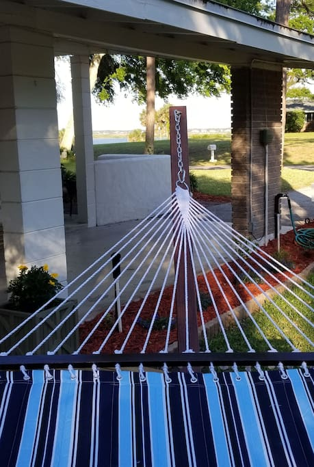 Relax on a hammock while enjoying the water and breezes