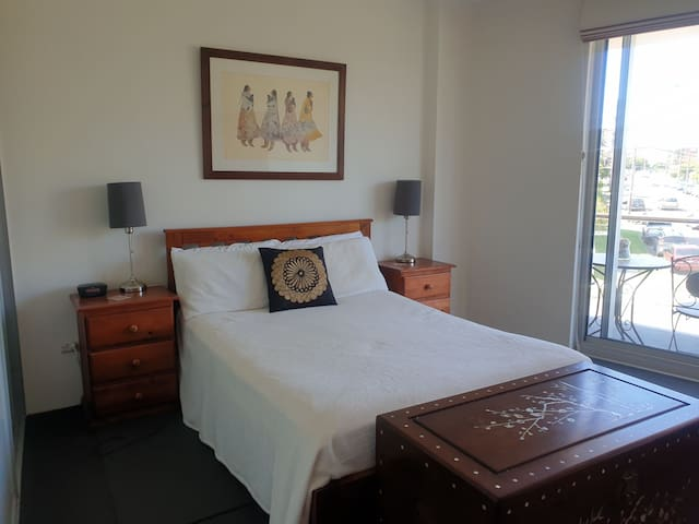 Large bedroom with double bed and a beautiful view. Bedside table drawers for you to store your belongings.