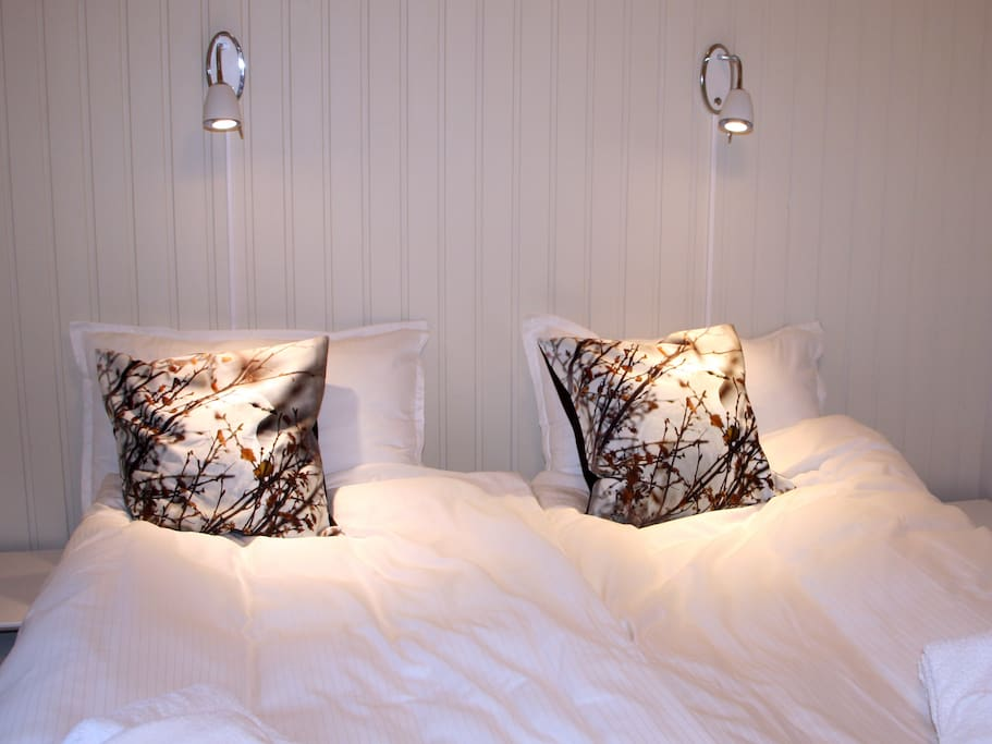Bedroom 1, 3 or 5. Double bed. All rooms include a wash basin, a closet and a chair and beds are fully made with sheets, pillows, duvet´s and towels.