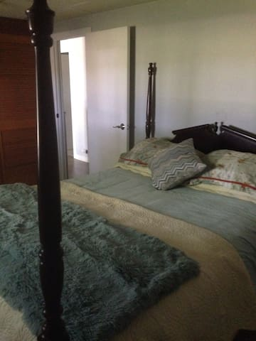 Carpeted bedroom, with wall to wall closet with plenty of room for hanging and  shelves for your clothes