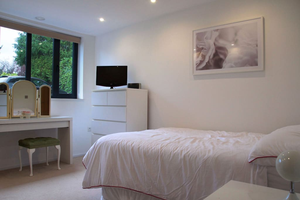 Master bedroom with double bed and plenty of hanging space and drawers