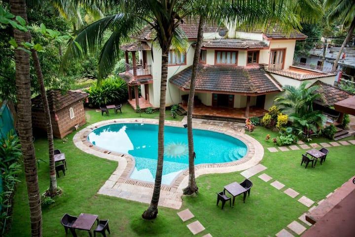 Pool facing Villa near Morjim Beach