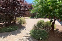 Common area courtyard, patio and pathway to laundry room.