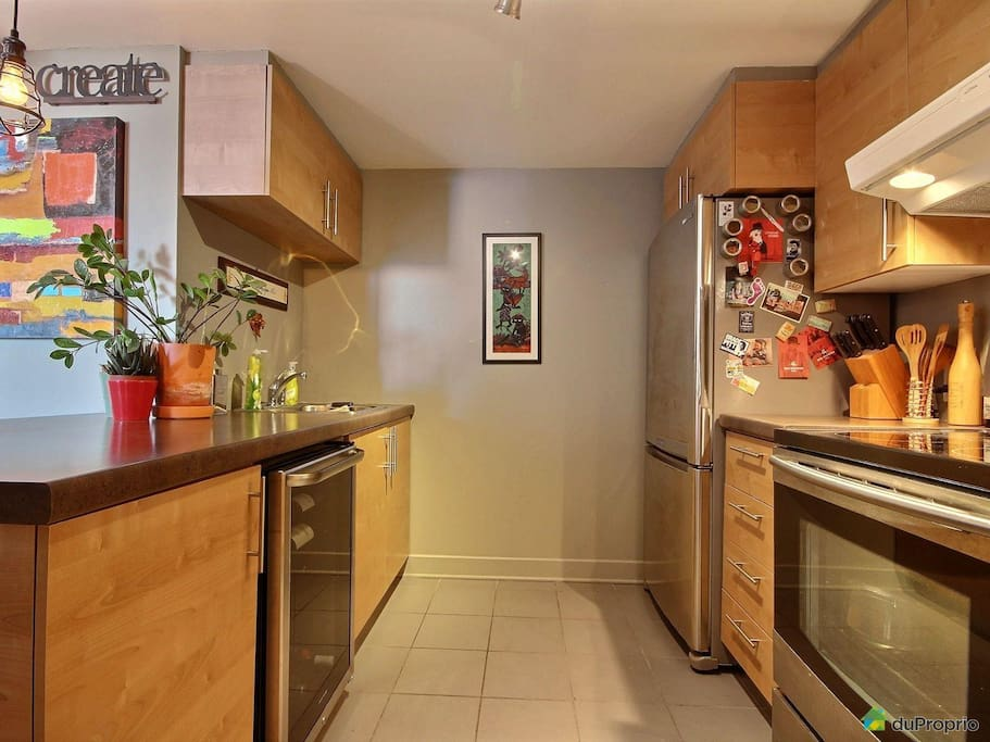 A spacious and modern kitchen with large countertops and modern appliances for your needs.