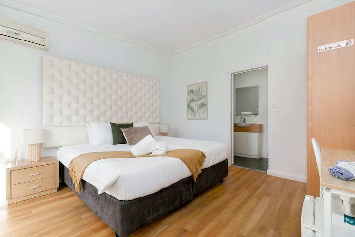 Bedroom complete with king bed, bedside tables, dedicated study desk & wardrobe for your belongings!