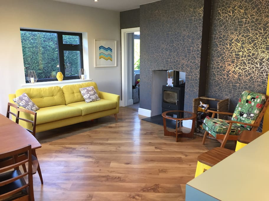 Kitchen Living/Dining area with double sided log burner (going through to playroom)