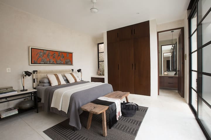 Light and airy master bedroom with comfy mattress and  bedding, A/C, iron and ironing board.