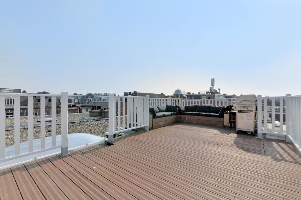 The large rooftop terrace boasts a comfy lounge area