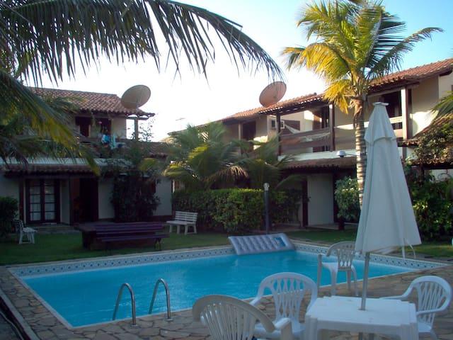 House in condominium, two blocks from the beach!