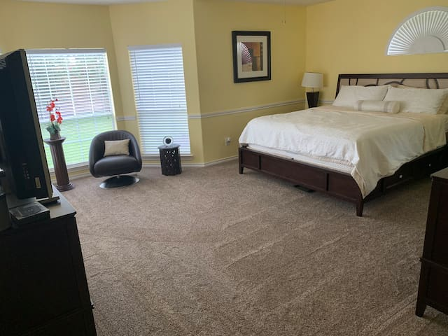 Master suite with private bathroom and whirlpool.