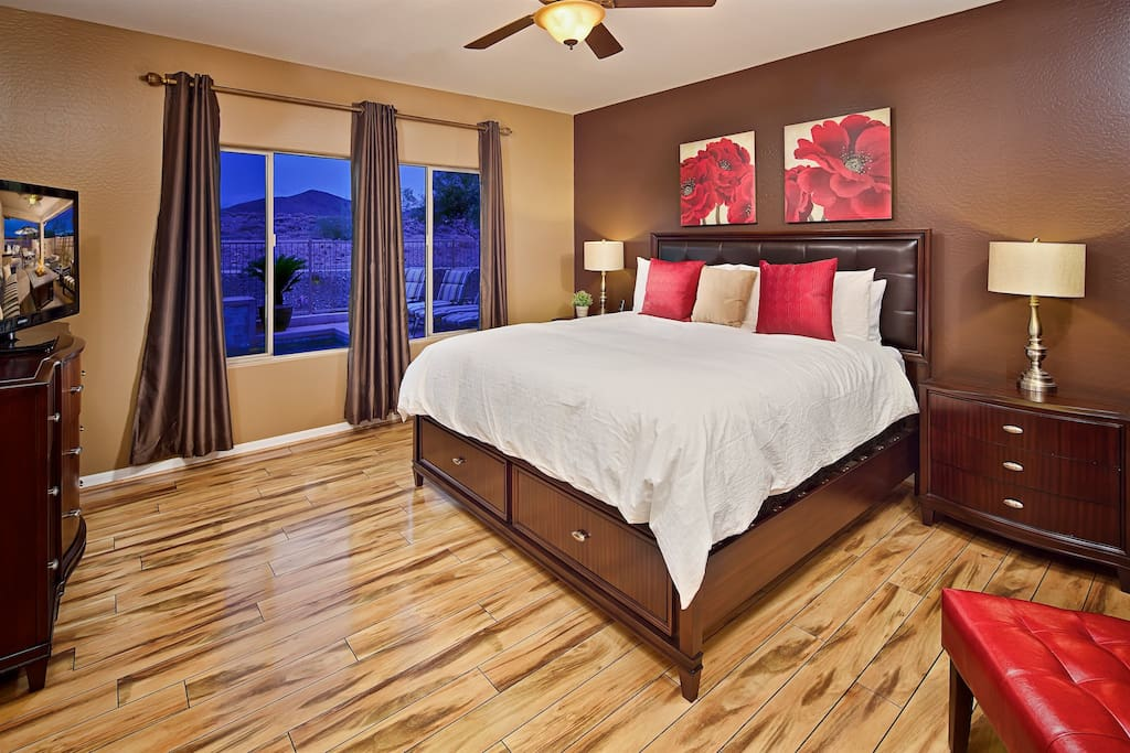 Luxurious master bedroom with mountain view.