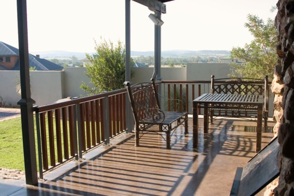 Lovely stoep with outdoor braai overlooking the pool.