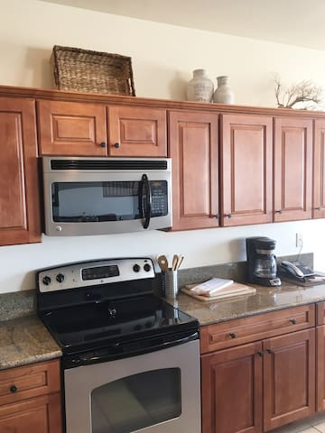Kitchen has maple cabinets throughout