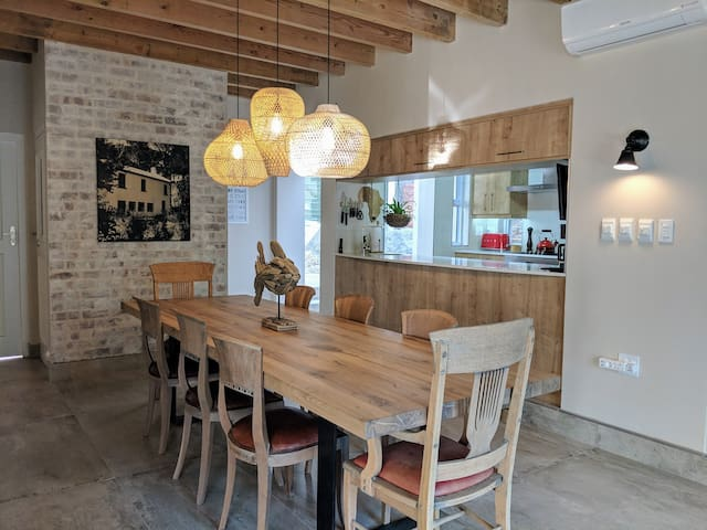 Dining room and galley kitchen. 10 seater table,  air conditioning, wood burning fire place