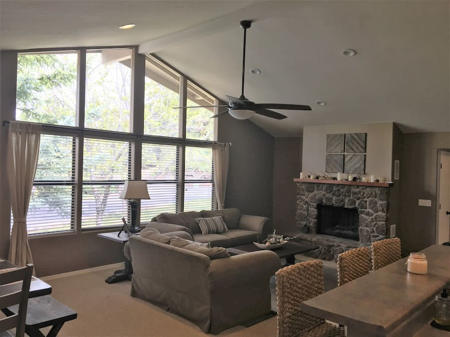Living room with vaulted ceilings.  Fireplace is not currently available for use.