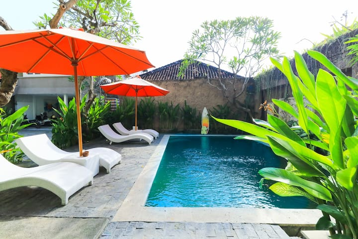 Walk to Kuta shops from a spacious room w a pool