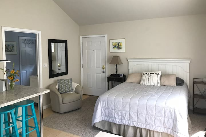 Queen bed with two nightstands, reading chair
