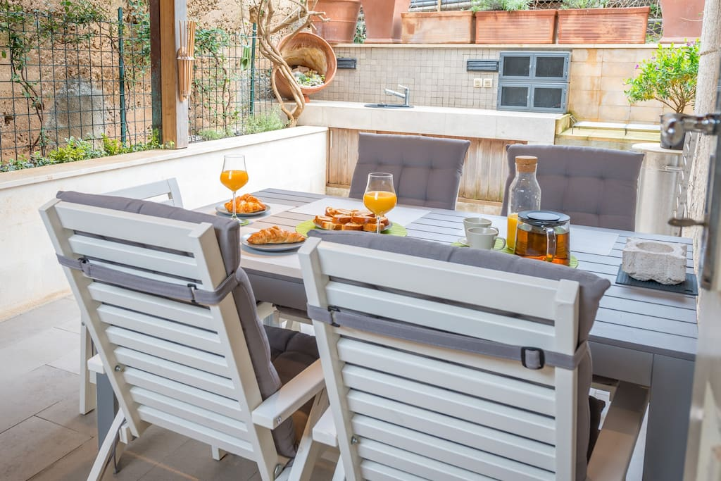 spacious terrace with outdoor seating area