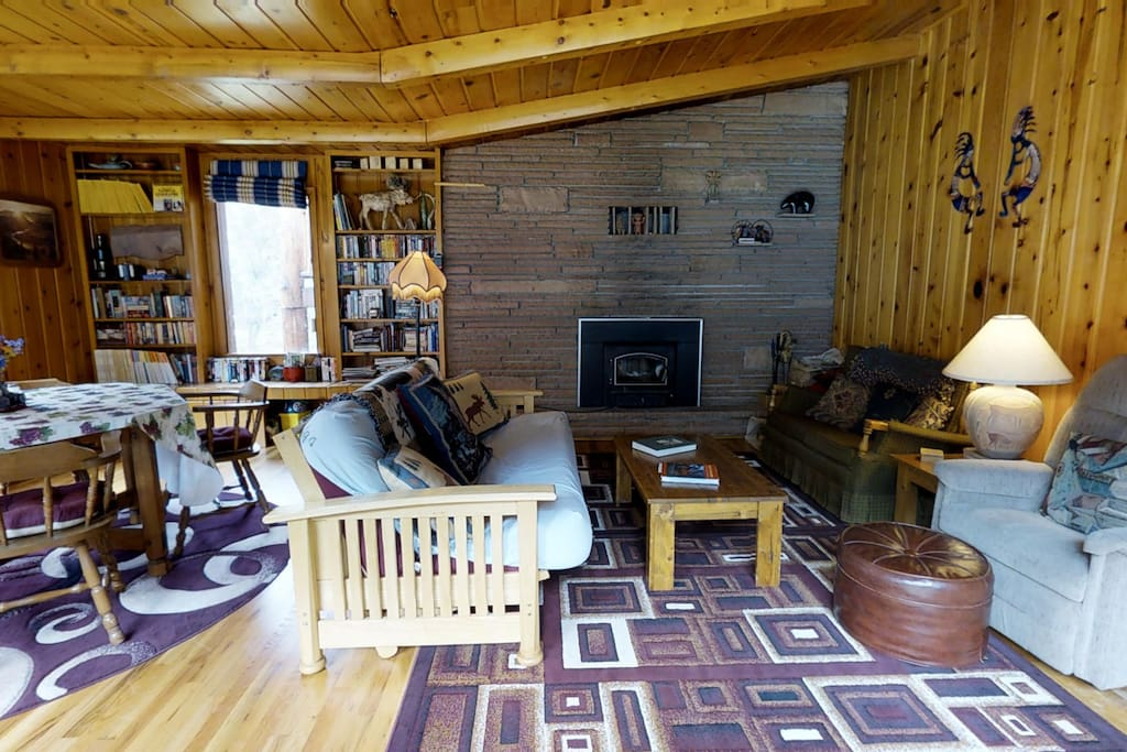 Great room overlooks river,  fireplace insert.  Wi-fi, TV is CD use only, not live TV. Who needs it?!  Cozy!