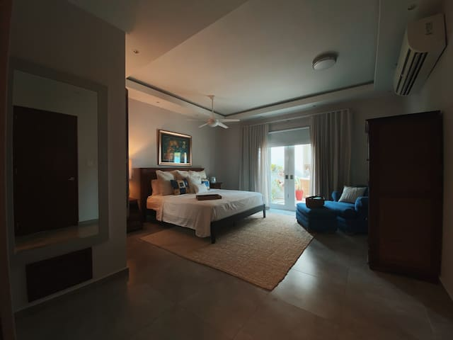 Master bedroom with en-suite bathroom including whirlpool spa tub, walking closet and a private doorway to the pool.