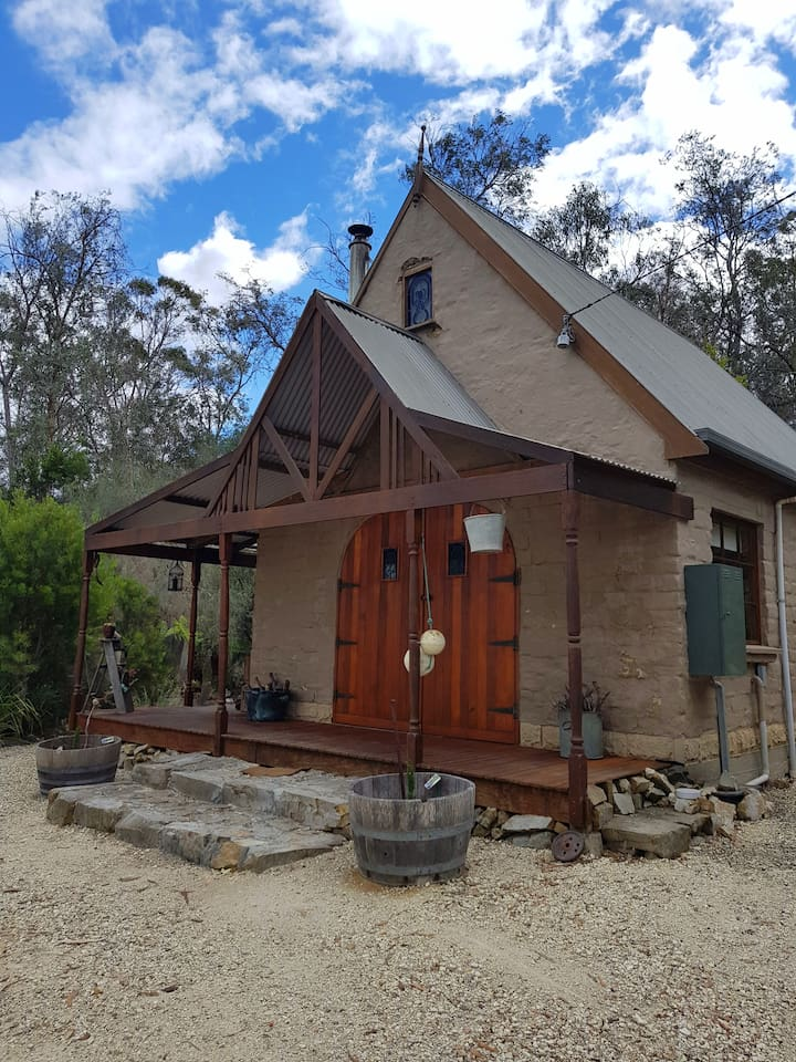 The small and quaint Heatherbell Cottage was hand built with mudbrick. This is a cozy little home with lots of quirks.