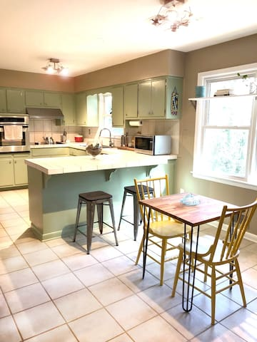 The Dining/Kitchen area is clean and spacious with seating for 4 and all the basics for cooking a good meal.