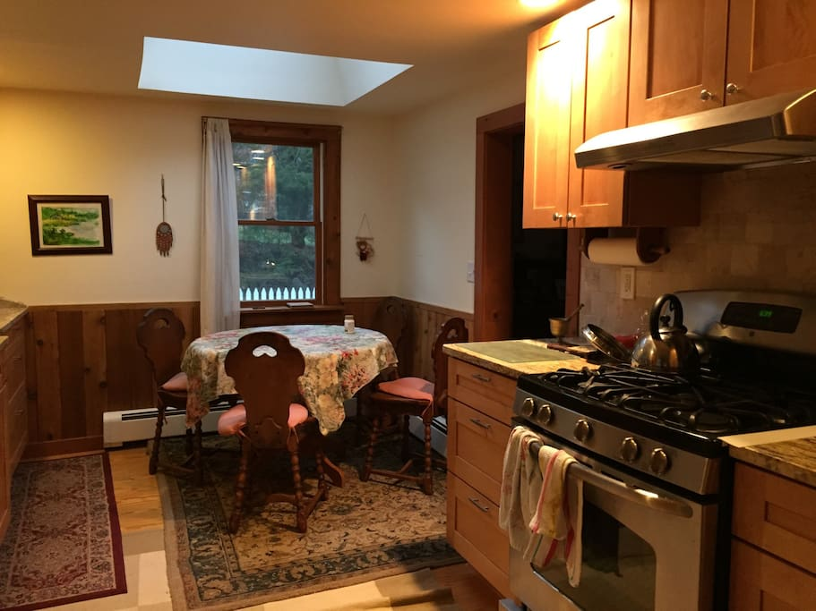 Eat in kitchen with gas stove and dishwasher