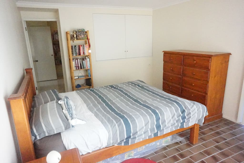 Your bedroom with cupboard and separate tallboy. Door through to the living area and bathroom.