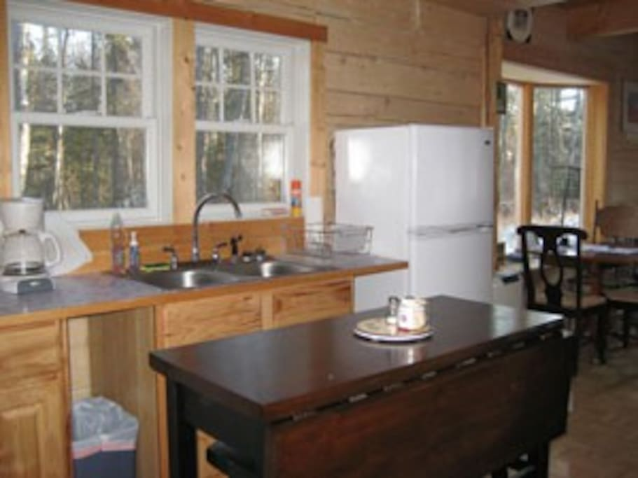 The functional kitchen also has a four burner propane range with oven.