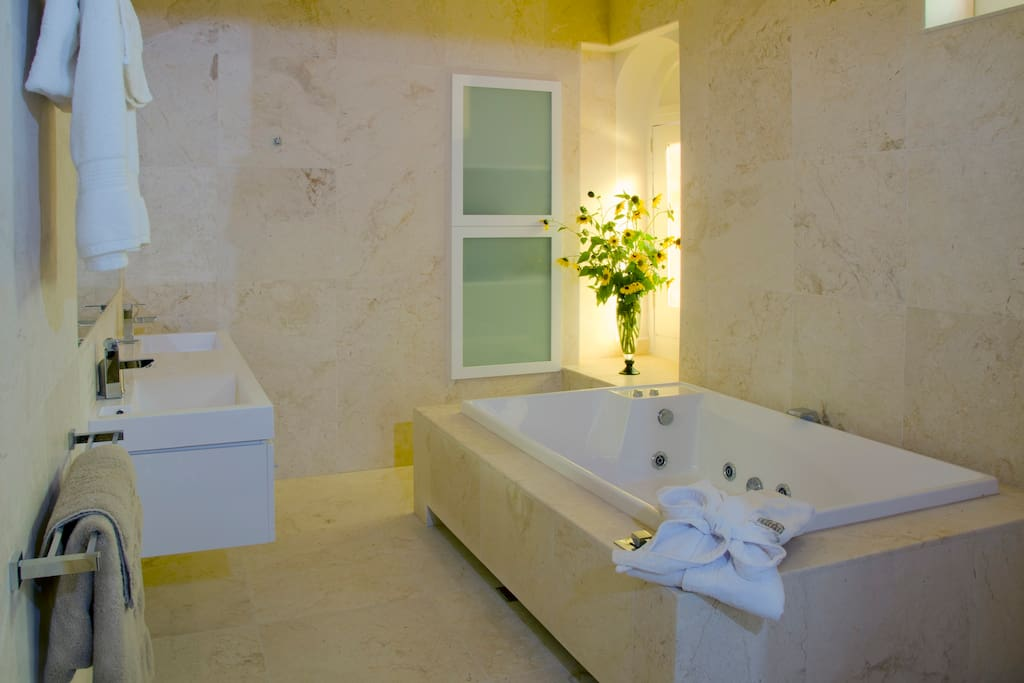 Master Ensuite Spa. Honed Limestone throughout.