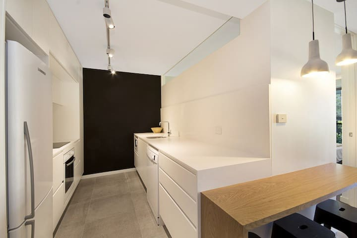 Modern contemporary kitchen, fully equipped with dishwasher, microwave, oven, hot plates and full size fridge