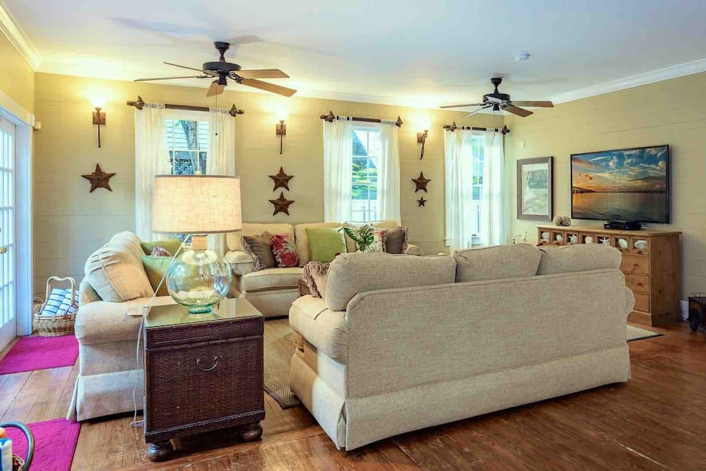 The living room has a large flat screen TV and plenty of comfortable seating for everyone...