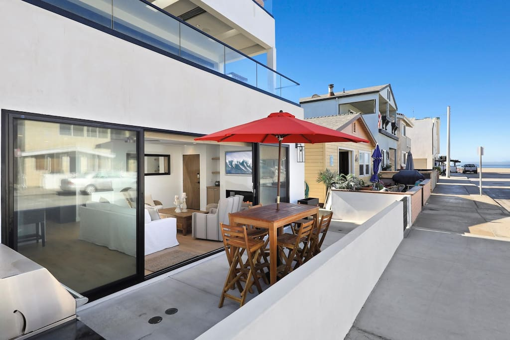 Our beautiful downstairs condo provides seamless indoor/outdoor living with views to the 30th Street beach just 1/2 block away!