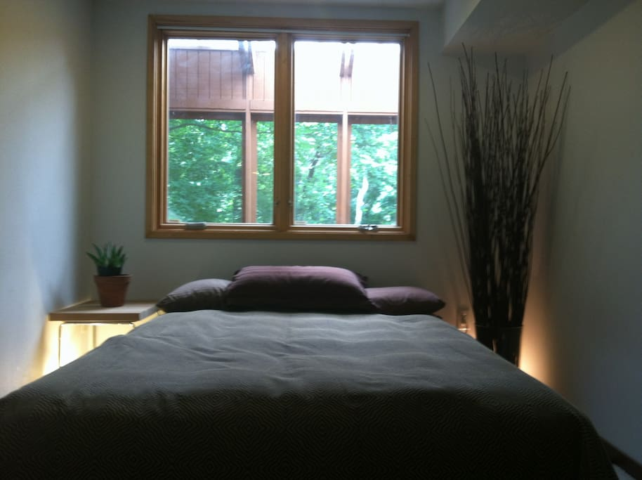 Bedroom with view of the woods
