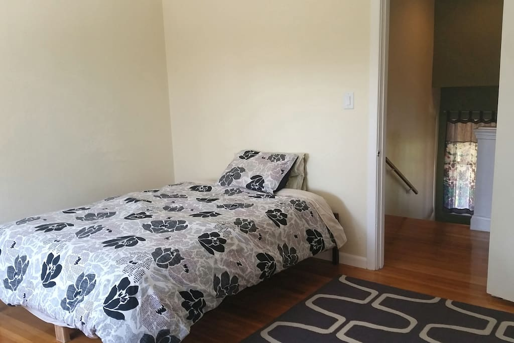 Bedroom: double bed, closet (not shown), natural light galore