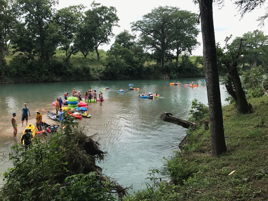 The sandy shoal right off our river frontage is a popular spot to party with other tubers!